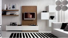 """О стиле """"минимализм"""" уже несколько лет много говорят и пишут дизайнеры. Он привлекает своей изысканной простотой, четкостью линий, сдержанностью цветовой гаммы. Даже небольшая комната, выполненная в подобном стиле, сразу наполняется простором и воздухом. Но вот, что удивляет: большинство картинок, которые обычно прилагаются к статьям, выглядят совершено непригодными для жилья. Например, гостиная: ведь в ней должен быть не только диван, пара кресел и плазменная панель. Вокруг телевиз..."""