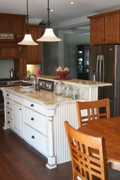 Beautiful #kitchen accent island w/ raised bar. Tell us what you think - www.twitter.com/legacycrafted #cabinetry #cabinets