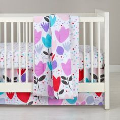 not your traditional pink... Tulip Festival Crib Bedding    The Land of Nod