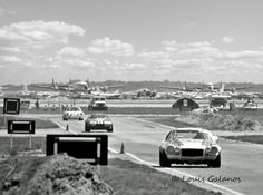 https://flic.kr/p/EFQ81p | Lockheed Constellations at Sebring 1972 | A great photo of mine from the 1972 Sebring 12 Hours showing cars coming out of turn three and heading to turn four and the Esses.  Between the Camaro and the 911 Porsche is the NART Ferrari 365 GTB/4 of Sam Posey and Tony Adamowicz that came in 13th overall.  In the distance you can see a couple of vintage Lockheed Constellations destined to be scrapped.