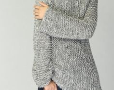 New design for this FALL/ WINTER! This beautiful and unique tunic sweater vest will make you stylish and on trend. It is made of 100% eco cotton yarn in a nice charcoal/ darl grey shade. No itch at all! It has unique trim pattern designed on top neckline, sides and bottom.   It is features on: 1. drop shoulder style 2. unique trim pattern designed on top neckline, sides and bottom. 3. rolled edge at neckline and hemline.  Other colors are coming up!  Size: S(us 0-4) M(us 6-8) L(us 10-12)…