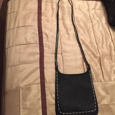 Fossil black leather and pony hair cross body Fossil black leather and pony hair cross body. Front flap with self snap closure. Inside zip pocket. Strap and outside of purse is in very good condition. The inside is in good condition. No rips or tears. Inside interior wipe out with a wet cloth to remove stickiness of a piece of candy that was previously in the bag. Fossil Bags Crossbody Bags