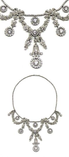 Belle Epoque diamond garland necklace, c.1905, millegrain-set with diamonds throughout, the collet-line necklace suspending three foliate swags composed of leaves and flowerheads, with ribbon junctions between and circular diamond cluster drops, open-set in platinum.