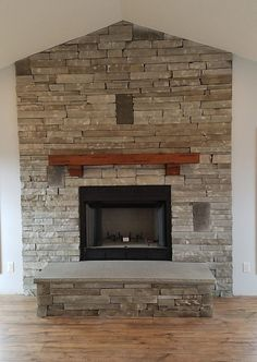 Happy First Day Of Autumn!!  So with it being the First Day of Autumn which bring warm color tones to mind we thought we would share just the opposite - a cool color tone fireplace. Check out this fireplace done in Gray Strip Rubble Natural Stone Thin Veneer from Elk River Stone. #elkriverstone #naturalstoneveneer #thinveneer #stonework #veneerstone #stonemason #naturalstone