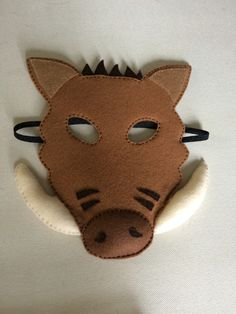 Made from felt, this warthog mask was fun to make. Padding in the tusks and nose too. Felt both sides with cereal cardboard in between in order to keep the shape.