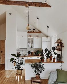 white modern bohemian kitchen decor high wood beam ceilings houseplants