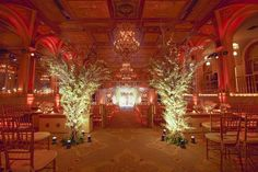 The Terrace Room of The Plaza Hotel with two tall arrangements at the beginning…