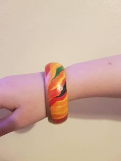 Check out this item in my Etsy shop https://www.etsy.com/uk/listing/578446345/hand-painted-wooden-bangle-of-a-swirly