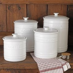 Embossed Kitchen Canister Set. Flour and sugar hold 10-lb. each. Brown sugar canister holds 6-lb. Coffee canister stores 1-lb., 10-oz. of ground coffee.