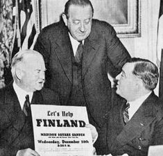 """Former US President Herbert Hoover, Dr. van Loon, and Mayor Fiorello LaGuardia raising funds for Finland for the Winter War, New York, NY, 20 Dec 1939. """"Let's Help Finland"""" event held at Madison Square Gardens."""