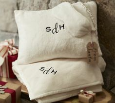 Monogrammed travel Set pillow, eye mask and blanket. Great gift for a frequent traveller. On sale for $79 at pottery barn