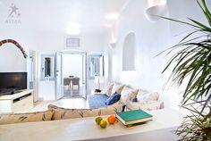 Santorini Hotels Imerovigli - Astra Luxury Suites in Santorini offer family hotel suites apartments accommodation in Imerovigli Santorini overlooking the sea and volcano Imerovigli Santorini, Santorini Hotels, Hotel Suites, Luxury Villa, Traditional House, Living Room, Studios, Architecture, Furniture