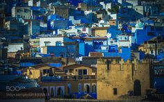Blue roofs by eliasharrak1  sky city street travel blue sun light old tourism urban architecture roof cityscape building culture