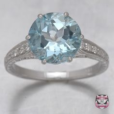 Edwardian Aquamarine Engagement Ring. It's so pretty! I'd probably want a slightly smaller stone though.
