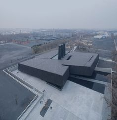 Sloping black volumes penetrate public square at Harbin's Exhibition Hall of Crime Evidences
