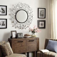 Showcase distinctive style with the Nihoa Mirror Collection. Round beveled mirrors adorn the intricate metal nest framing the large round mirror. This elegant layered look provides a beautiful centerpiece and add a new texture to your decor.
