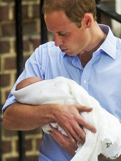 July 2013 ~ HRH the Duke of Cambridge gets to grips with fatherhood! He poses as he cradles his newborn son, Prince George of Cambridge. Prince William Family, Prince William And Catherine, William Kate, Prince Charles, Prince Henry, Princess Kate, Princess Charlotte, Diana Spencer, Elizabeth Ii