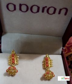 Indian Jewelry - delicate coral gold jhumki (bell shaped) earring - (makes an affordable and pretty gift for a young girl) - from Abaran, Bangalore (India). This style of earrings has its origin in Southern India; Bharatanatyam dancers wear them as part of their dance costume.