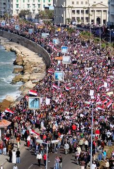 Egyptian anti-government protesters march in the coastal city of Alexandria on Feb. 11, 2011.