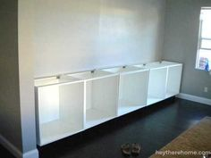 We found that IKEA kitchen base cabinets were perfect for the lower cabinets and. - Ikea DIY - The best IKEA hacks all in one place Wall Cabinets Living Room, Ikea Wall Cabinets, Built In Shelves Living Room, Built In Cabinets, Diy Cabinets, Diy Built In Shelves, Ivory Cabinets, Build Shelves, Upper Cabinets