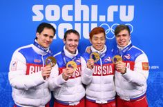 DAY 15:  (L-R) Gold medalists Vladimir Grigorev, Ruslan Zakharov, Victor An and Semen Elistratov of Russia celebrate on the podium during the medal ceremony for the Short Track Men's 5000m Relay http://sports.yahoo.com/olympics