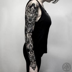 Heavy blackwork sleeve by Darkside Tattoo