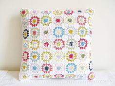 Pretty crocheted granny square pillow by Emma Lamb.