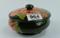 Collectors & General Auction – Lot 964 – Moorcroft Hibiscus on green ground lidded bowl diameter 13cm.  Sale Price £35.00