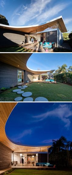 This modern curved roof slants upwards in the backyard, providing space for a set of clerestory windows. Circular stone steps create a path through the yard, connecting different spaces.