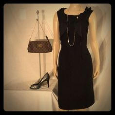Ellie Tahari little black dress Ellie Tahari Little black dress sophisticated and professional look with a very savvy front ruffle detail excellent condition no damage fabric is hundred percent polyester mid length Tahari Dresses Midi