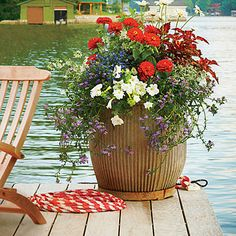 If summertime means lake time, then don't forget the dock. Add a splash of color in a red, white, and blue palette to the spot where you'll enjoy it most. | SouthernLiving.com