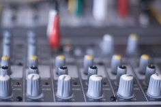 controls on an audio mixer by stockmedia
