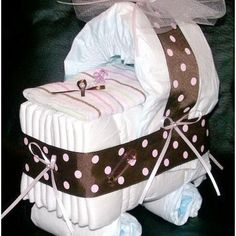 How cute. I've seen the diaper cakes, but never the diaper carriage!