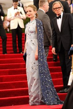 Emily Blunt in a caped Prada steel blue duchesse gown and cape with crystal and glass bead embroidery, at the Met Gala in 2015.