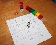 "A preschool math game for learning the value of larger numbers.  All you need is paper and something to serve as the ""die.""  It's better if it's not a die with numbers on it."