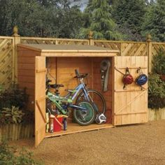 The Wall Store Wood Storage Shed is the ideal outdoor storage solution for items such as bikes, outdoor toys, pool equipment and garden tools. With easy access from the over wide double door opening, the Wall Store is both functional and practical. Wood Storage Sheds, Outdoor Storage Sheds, Outdoor Sheds, Outdoor Toys, Bike Storage For Small Garden, Outdoor Bicycle Storage, Bicycle Storage Shed, Garden Storage Shed, Petits Hangars