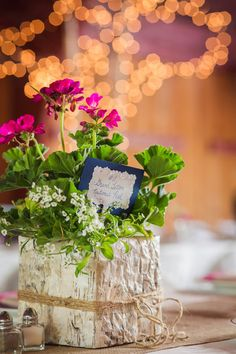 These wedding centerpieces featured square wood birch vessels