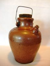 Brown Glazed Stoneware Oil Jug Pitcher with Bail Handle and Corks