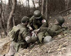 U.S. medics assist a wounded GI