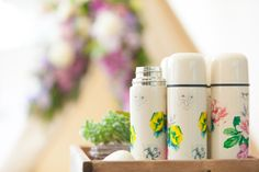 """A photo of our thermoses from our """"Poppytalk for Target"""" launch event (picnic basket and blankets)! Launches on June 22. Available for a limited time."""