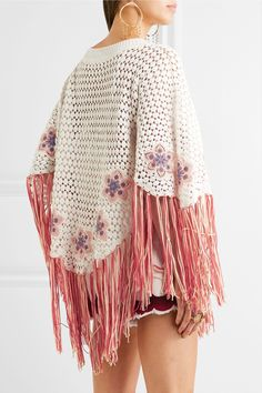 EXCLUSIVE AT NET-A-PORTER.COM. Chloé's High Summer '17 collection is inspired by '70s Ibiza. This poncho is embroidered with flowers and trimmed with swishy peach and red fringing. It's crocheted from soft ecru cotton and has discreet sleeves to hold it securely in place. Slip yours over a bikini or tonal tank. Ecru, peach and red crocheted cotton - Slips on - 100% cotton; trim: 100% polyester