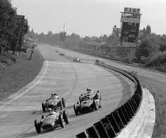 Stirling Moss with the offset-engine Maserati 250F leads the Ferrari-Lancia D50s of Juan Manuel Fangio and Peter Collins while Harry Schell challenges in the Vanwall on the fifth lap. Moss went on to win, but Collins handed his car over to Fangio late in the race. Thus Fangio went on to finish second and win another World Championship title. Schell had to abandon his car out on the course with a fractured oil line, another victim of the merciless pounding from the rough banking, Italian…