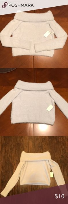 Fuzzy off-the-shoulder sweater New with tags, never worn. This sweater is slightly cropped. Super fuzzy and comfy. It's a very light, powder blue. I prefer looser fitting sweaters and this was a little too tight for my liking. Forever 21 Sweaters