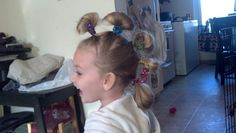 Crazy hair day at school! Put in ponies but don't pull hair all the way through. Extra hair can be added to next pony:) wrap with pipe cleaners of your choice and use a pencil (or whatever you choose) to curl ends:) she got lots of compliments:)!