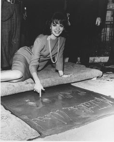 Natalie Wood signing her name at Grauman's Chinese Theater Hollywood