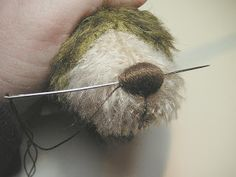 I thought this was interesting....I'll try it! How to embroider a bear nose
