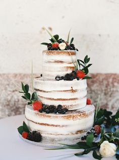 Strawberry and blackberry infused three tier wedding cake: http://www.stylemepretty.com/2016/11/28/southern-brunch-wedding/ Photography: Jake and Heather - http://jakeandheatherphoto.com/