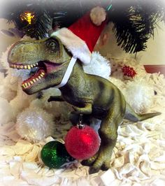 Rufus our Christmas Dino http://www.lifewiththecrustcutoff.com/rufus-christmas-dinosaur/
