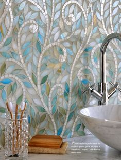 Climbing Vines, a jewel glass waterjet mosaic, is shown in Aquamarine leaves and Quartz vines. New Ravenna Mosaics 2010 Backsplash Herringbone, Beadboard Backsplash, Mosaic Backsplash, Mosaic Tiles, Backsplash Ideas, Grey Backsplash, Tiling, Mirror Backsplash, Fireplace Backsplash