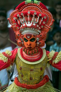 Cross eyed dancer - Theyyam perfromer preparing for his routine in Kerala, India